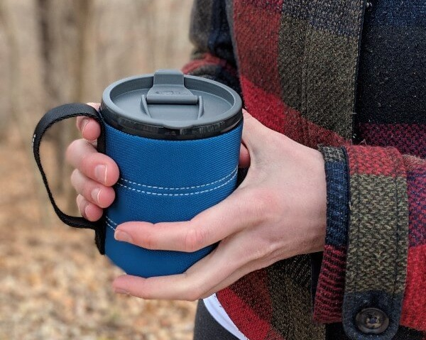 gsi infinity best camping mug in woman's hands standing outdoors