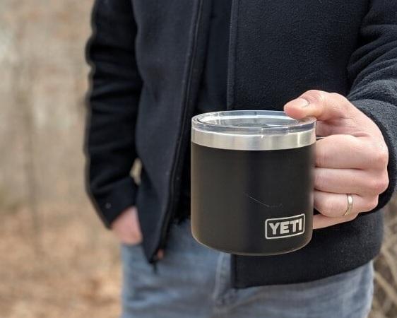 best camping mug yeti rambler 14 in man's hand standing outdoors