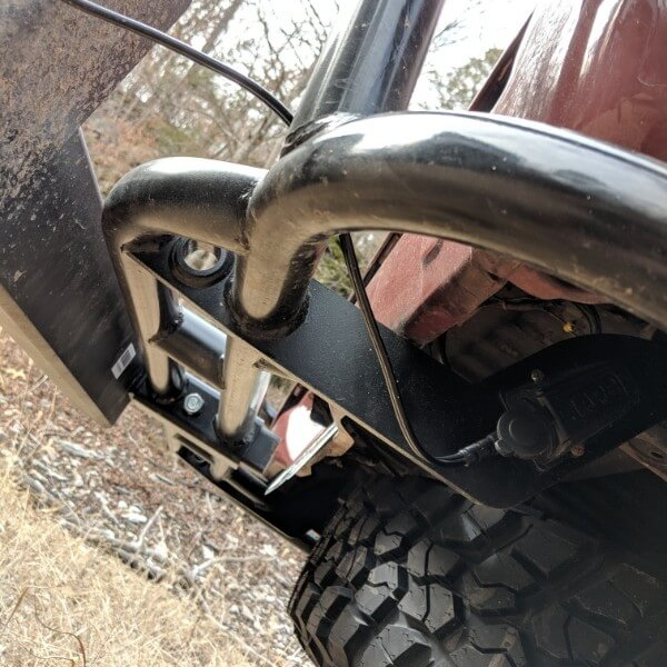 camping fridge plugged in to arb 12 volt outlet on underside of toyota truck camper