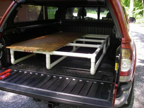 pickup truck with pvc built sleeping platform plywood on top