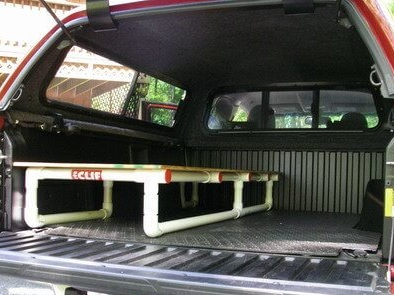 truck camper with lightweight pvc frame for sleeping platform
