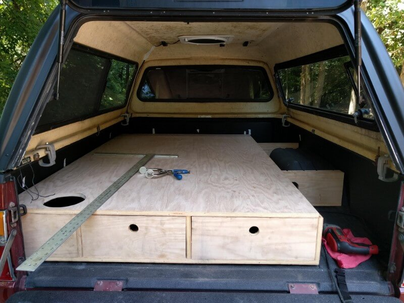 sleeping platform build with built in drawer storage