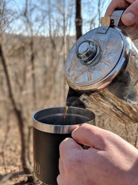 pouring cowboy camping coffee into yeti mug