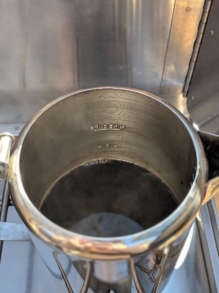 cowboy camping coffee in percolator grounds sinking to bottom