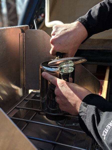 add cold water to camping coffee pot for cowboy coffee