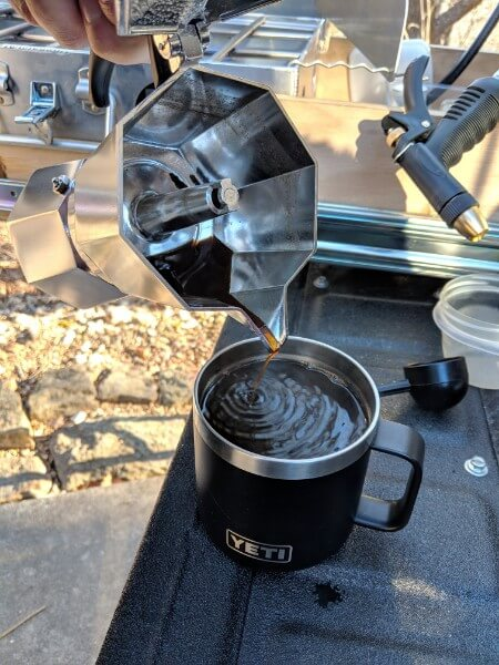 pouring bialetti espresso camp coffee into yeti mug