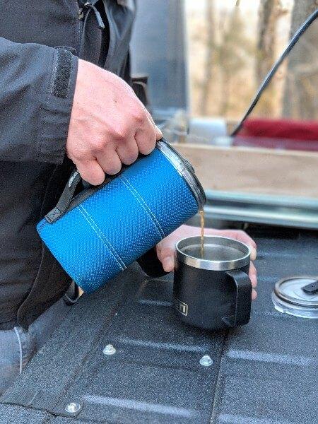 pouring camping coffee from gsi javapress into yeti mug