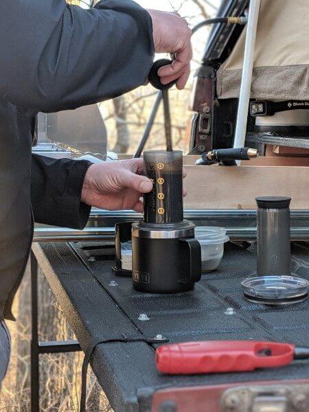 stirring coffee grounds in aeropress chamber