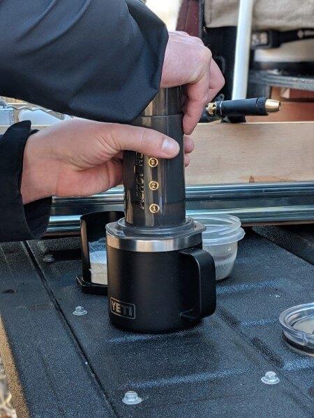 making camping coffee in the aeropress
