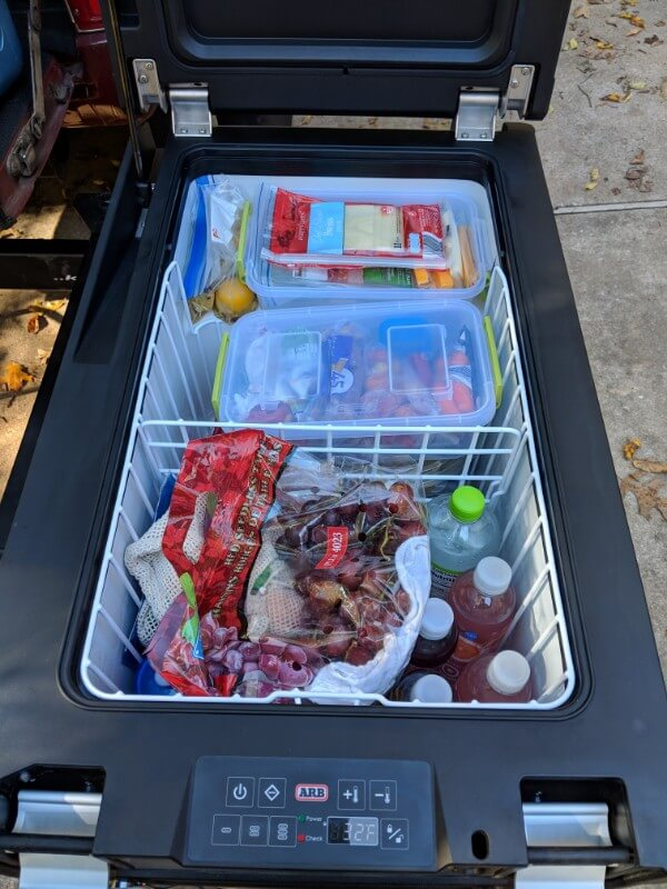 arb camping fridge packed in an organized way to make camping meals easy