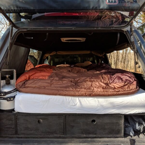 milliard trifold memory foam camping mattress in truck shell camper with sleeping bag