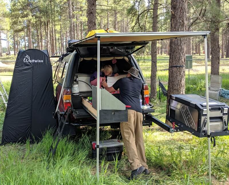 Shower tent deployed while truck camping