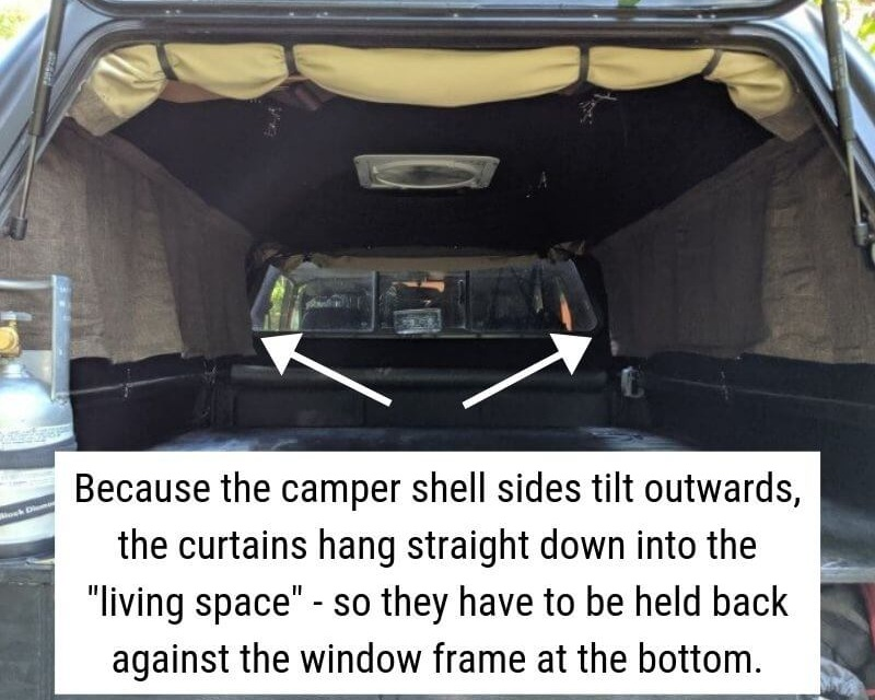 Figuring out how to hold curtains back against a truck shell camper.