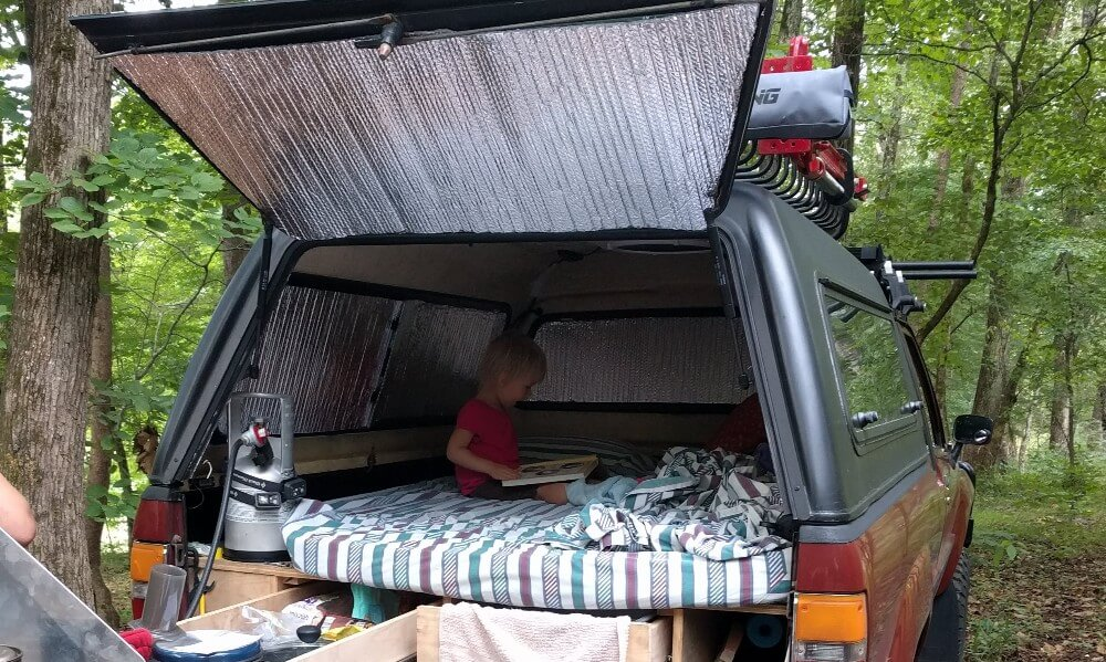 Reflectix being used as window covers for DIY camper curtains.