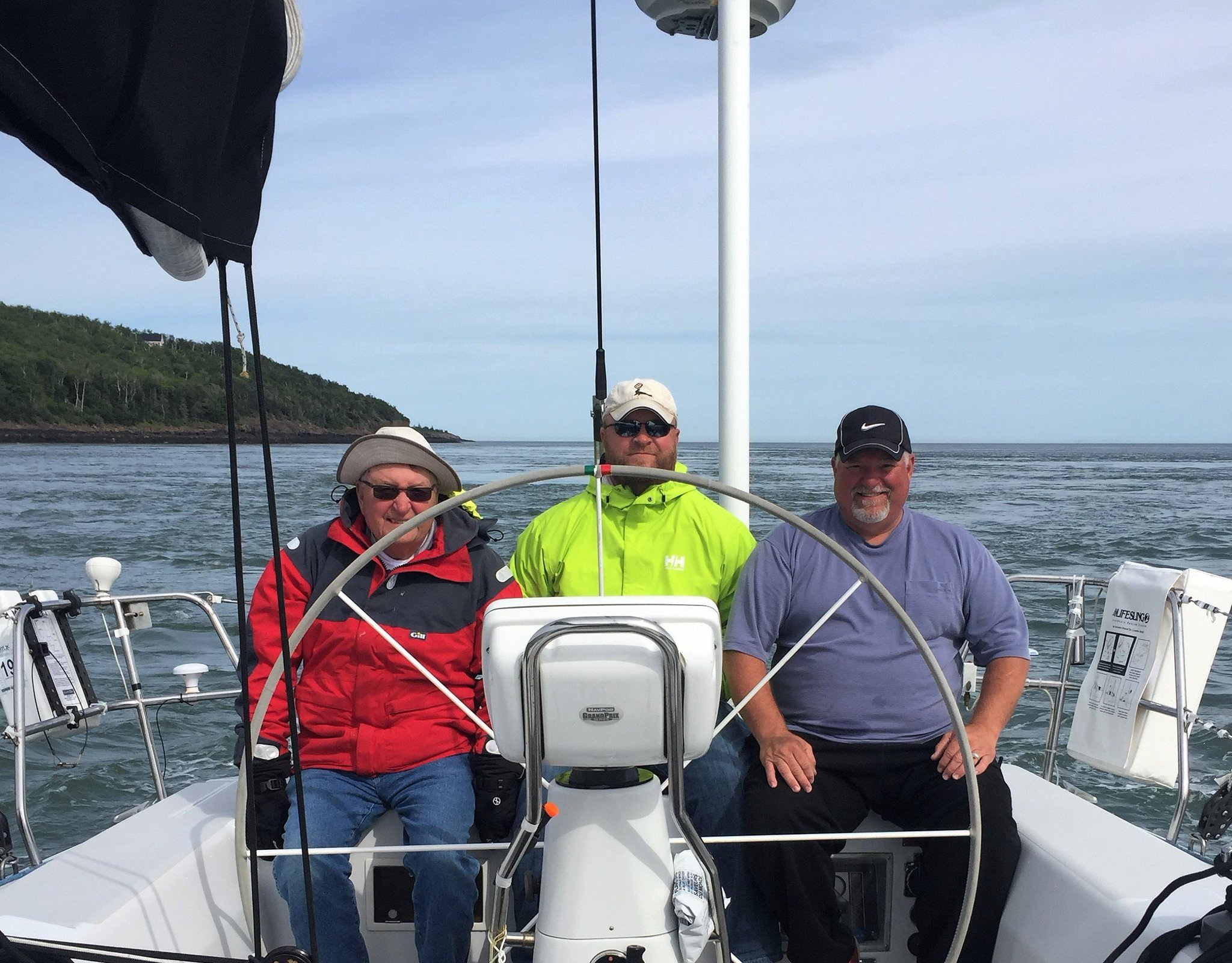 Tom (past president), Tom (president), and Keith (vice-president) on a family sailing trip