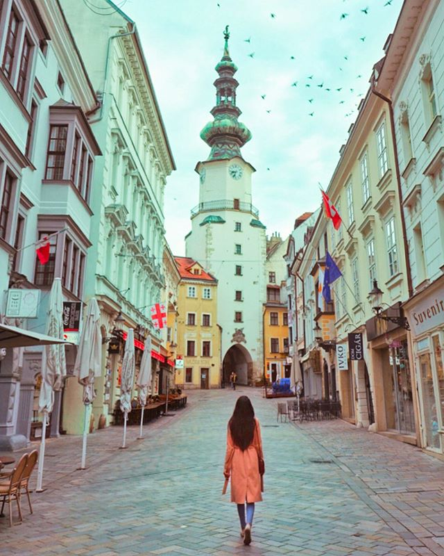 "Just got back to England last night, and I am ALREADY missing all the stunning European cities we traveled through these past few weeks!🤩 • One city that really surprised me (because I knew nothing about it🙈😂) was Bratislava! We were only there for one night, and at times it felt like a beautiful ghost town.👻 Haha it because it was a rainy day, and when the sun came out the next day, it was much busier. • It's always fun visiting a place that is less familiar to me or maybe a bit more ""off the beaten path..."" especially when all the tourists are hiding indoors!😉🙌🏼☔️ . . . #Bratislava #bratislavaslovakia #travelslovakia #slovakia #visitbratislava #visitslovakia #slovak #slovakiatravel #wearetravelgirls #eurotrip #journeysofgirls #travelgirlshub #travelcommunity #besttravelpics #travelgirlsgo #travelwomen #womentravel #besteuropepics #easterneurope #bestcommunitytravel #wanderontravelcommunity #womentravel #travelblog #travelblogger #thewanderingtourist #sheisnotlost #roamingwomen #roamingnaomi"