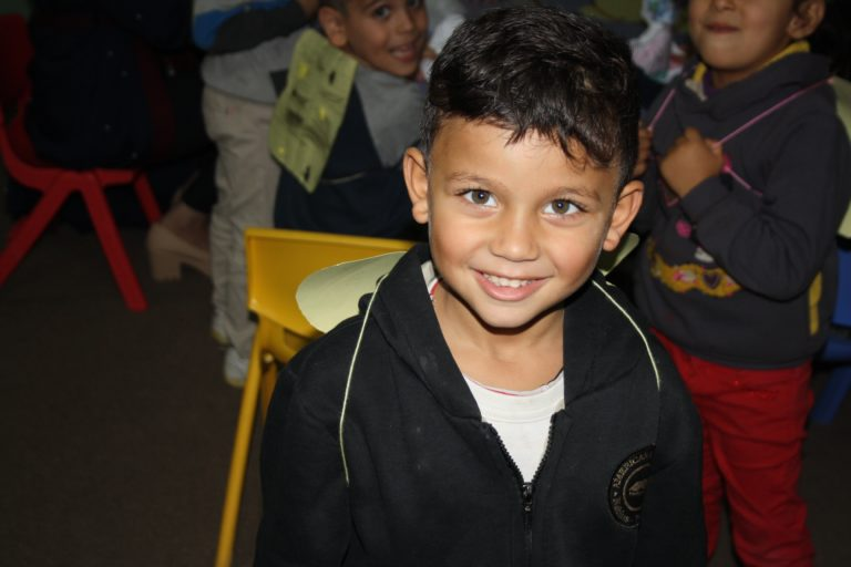 Core student Ali smiles with his bee wings.