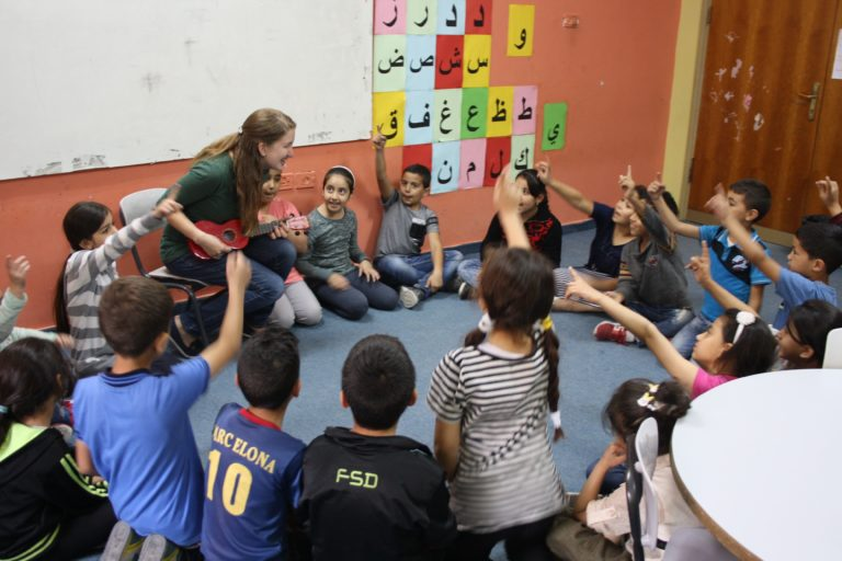 International Intern Katherine sings with her Core Early Childhood education class.