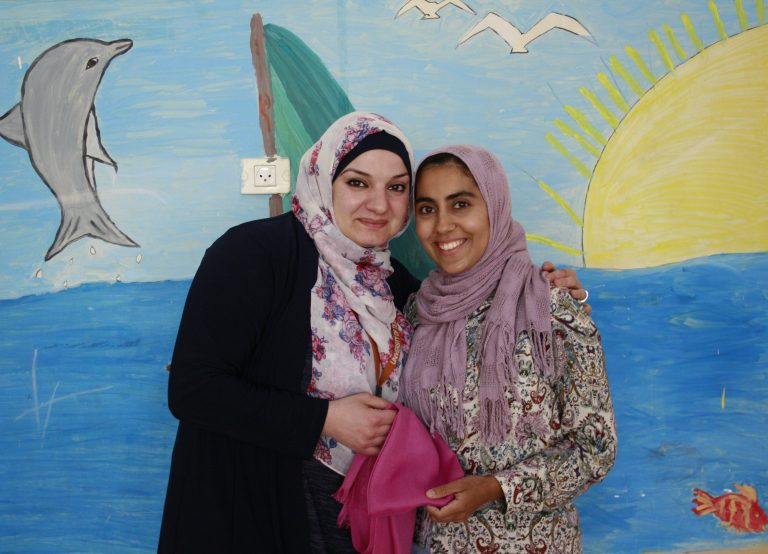 TYO Core Teacher Fawz and Haya spend time together in a Core classroom.