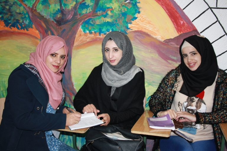 STEP! II EFL students Narmeen, Reham, and Waed enjoy their English class taught by international EFL Fellow Catalina.