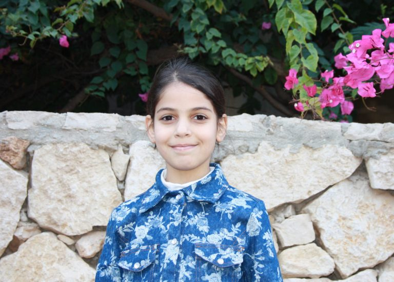 Sabah's daughter Aya participates in the After-school Academic Support for Kids program.