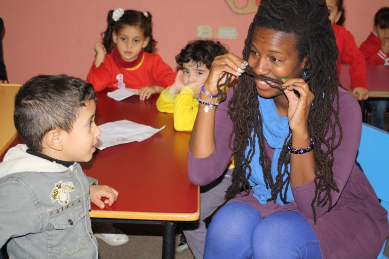 EFL Fellow Mecca plays with the children of a Core AM class before the lesson begins.