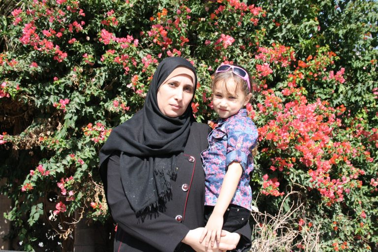 The Women's Group participant Wafa and her daughter, Core student Aya both enjoy their time in the sunshine after their classes at TYO.