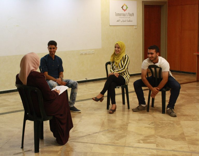 EFL students participate in a skit using humor to practice their English skills.