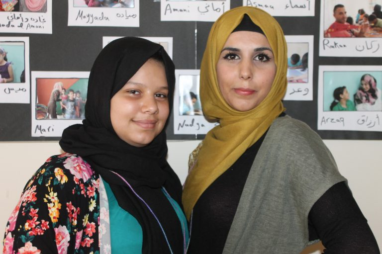Ro'a, 12, on the first day of the Summer 2016 Academic Support Program with her class's lead volunteer tutor, Basha'er.