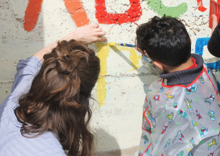 International Intern and Core student enjoy an outdoor art activity