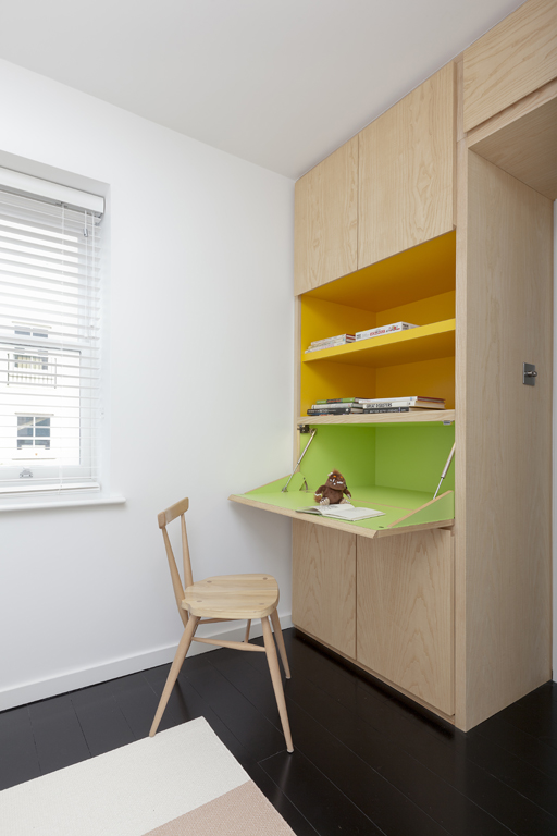 natural wood bespoke hidden office desk with yellow green accents