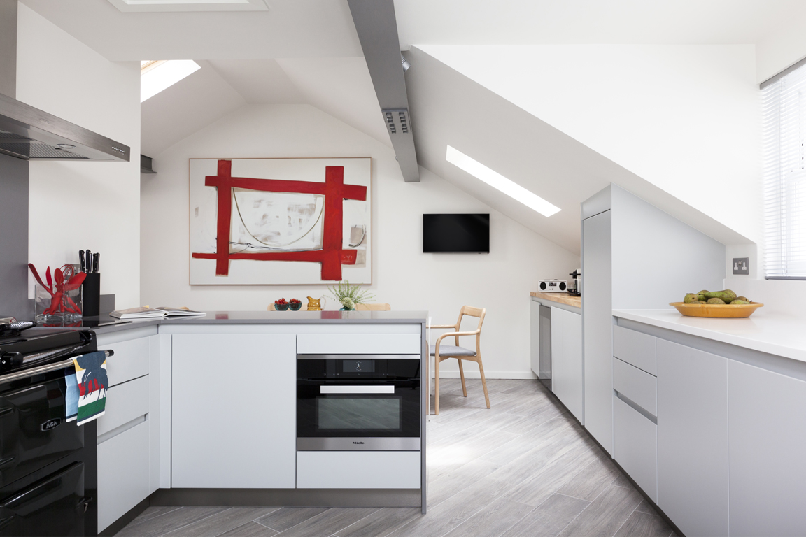 contemporary white kitchen with red art accents