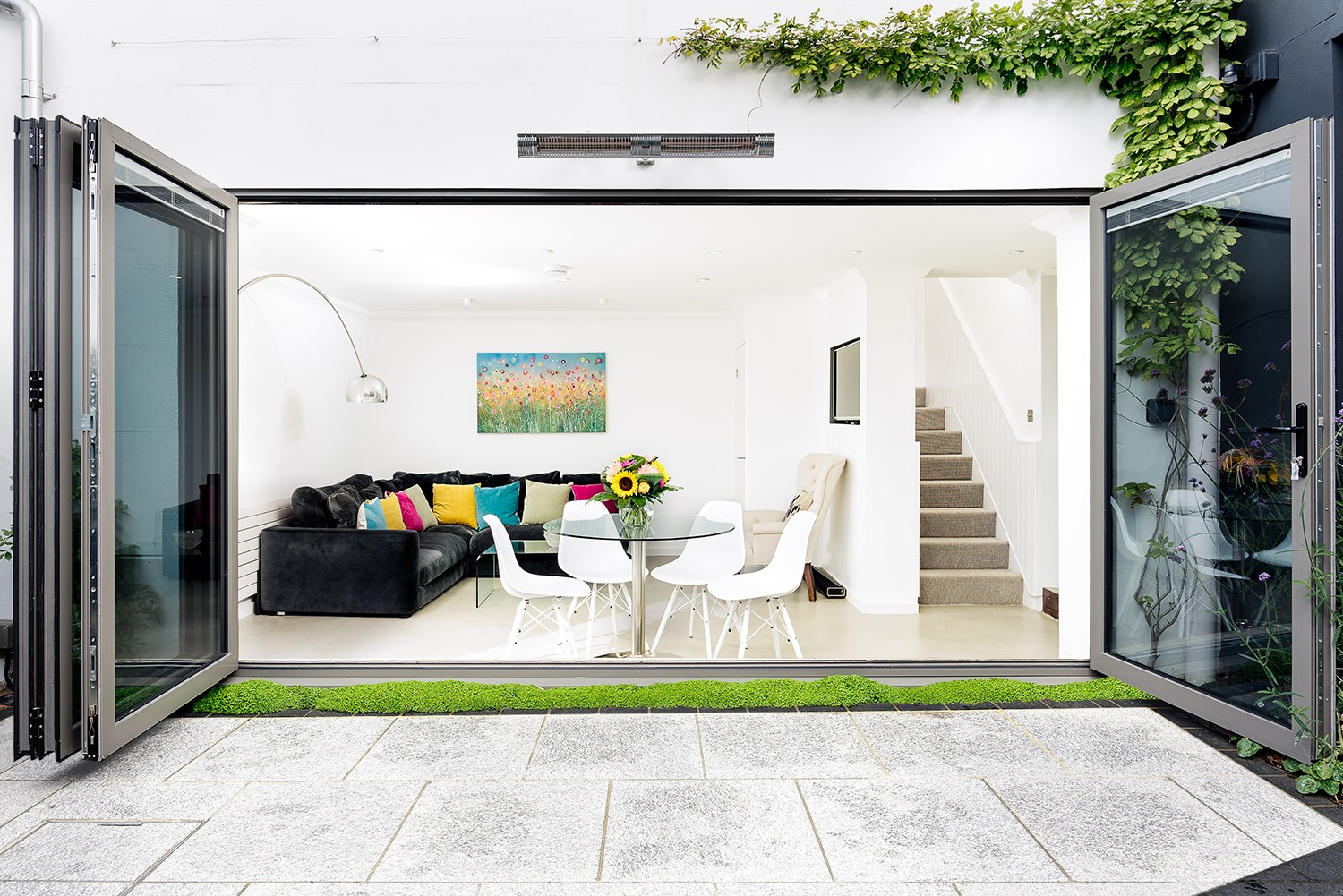 bifold doors opening up to contemporary living room