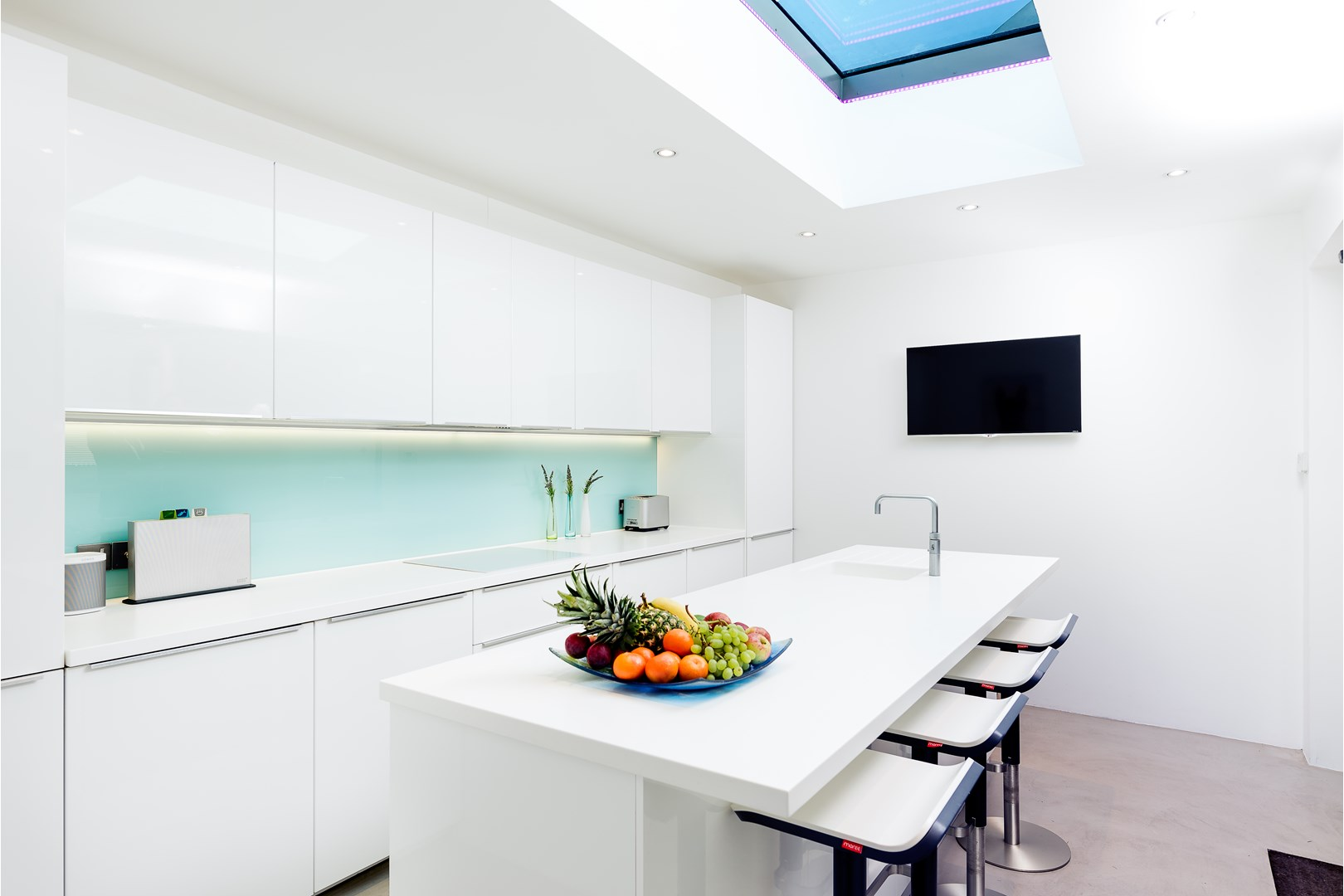 white modern kitchen with roof lantern