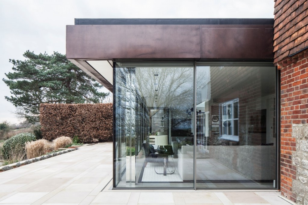 contemporary single storey extension to traditional building canopy