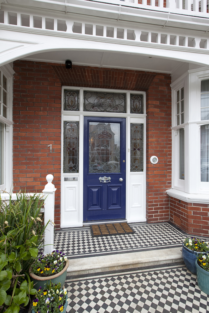 front entry with classic diamond tiling and brick facade