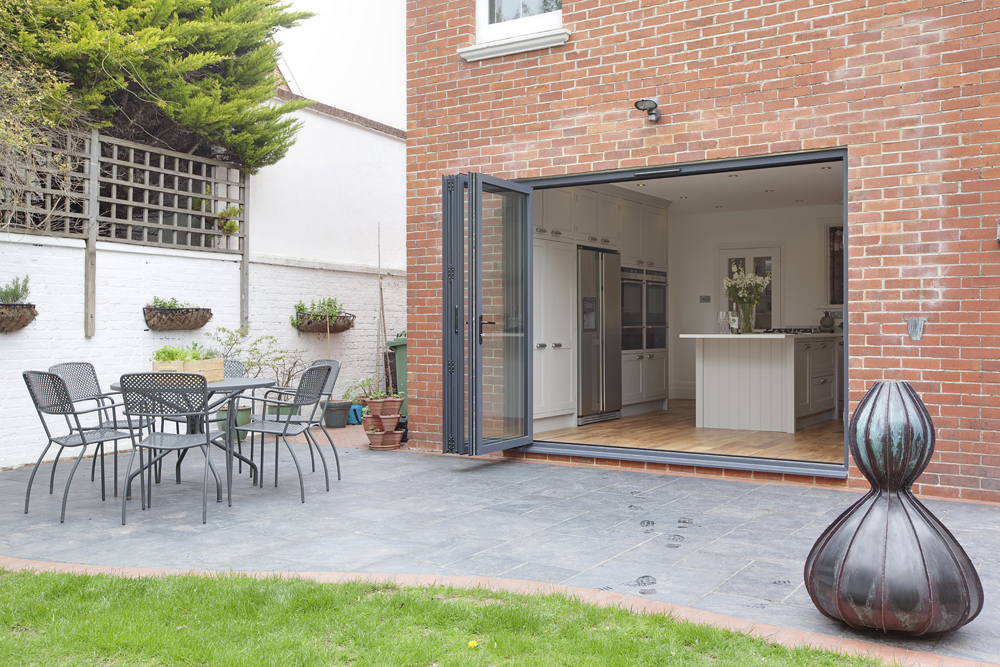 brick home with bifold doors connecting garden to kitchen