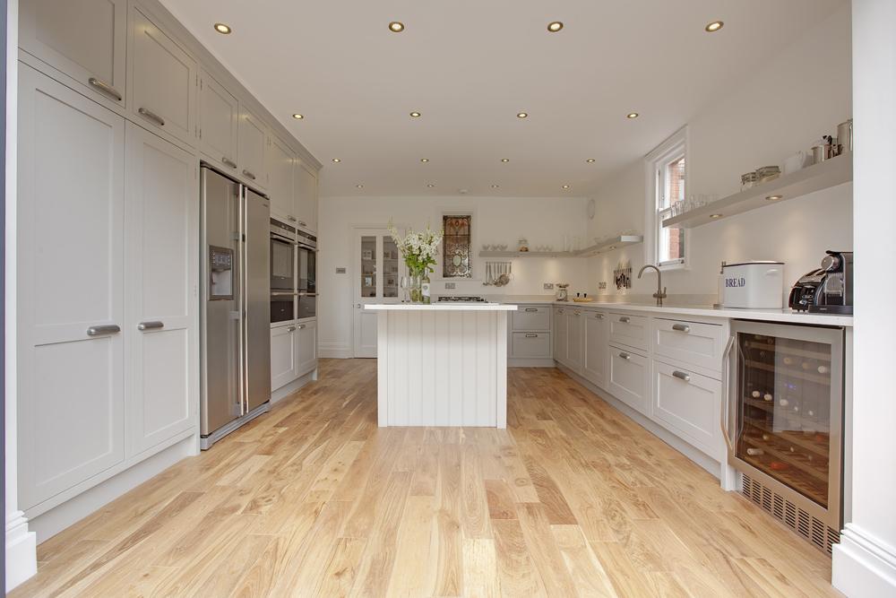 new classic grey bespoke kitchen with island and wine fridge