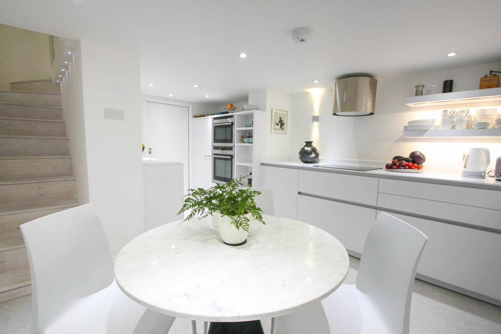 white bright kitchen on lower level