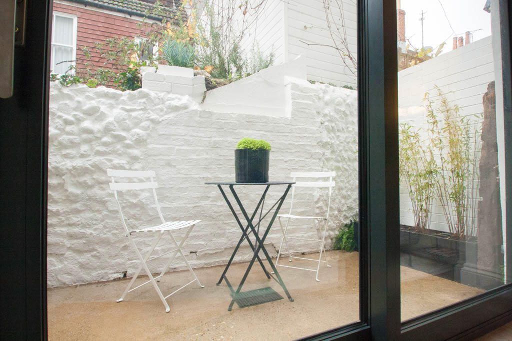 white brick courtyard space