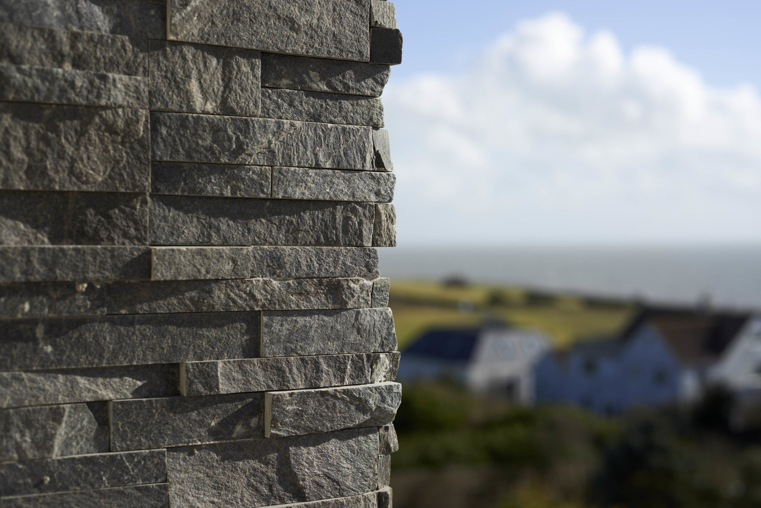 stone wall detail with view to sea beyond