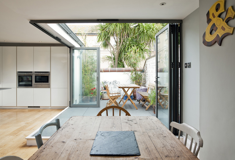 rustic dining table and contemporary kitchen and terrace