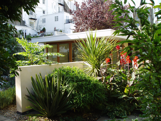 contemporary garden room in lush landscape within historic Grade 1 listed garden walls