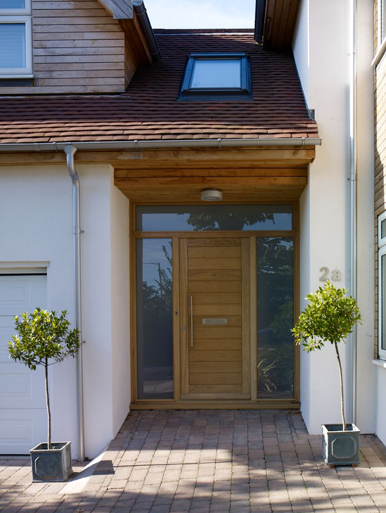 contemporary and welcoming entrance to renovated home