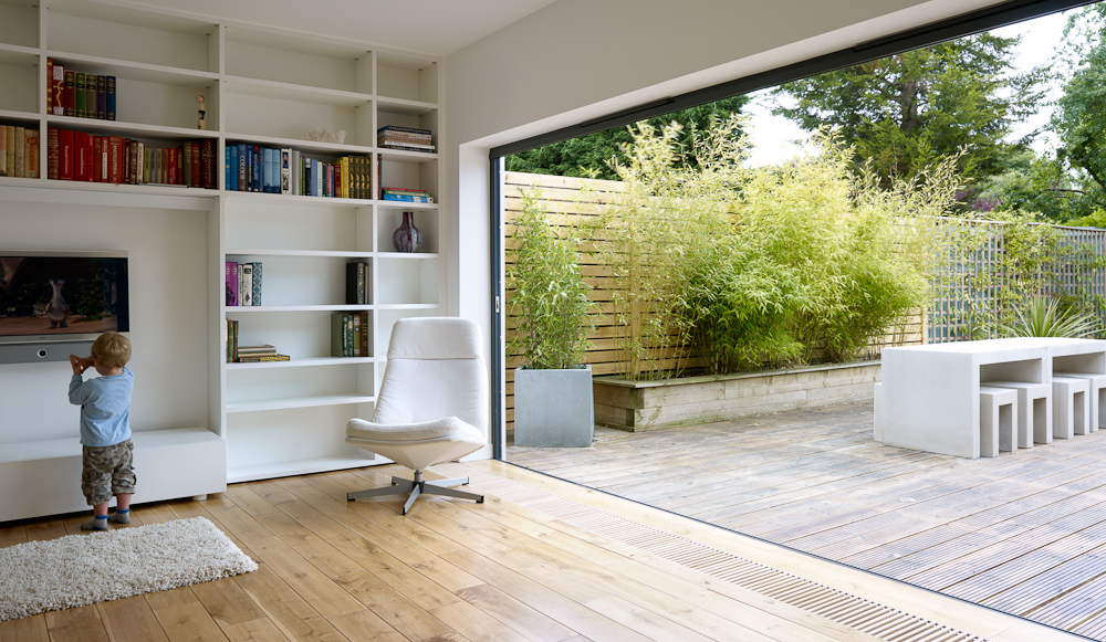 open plan living area spilling out to garden