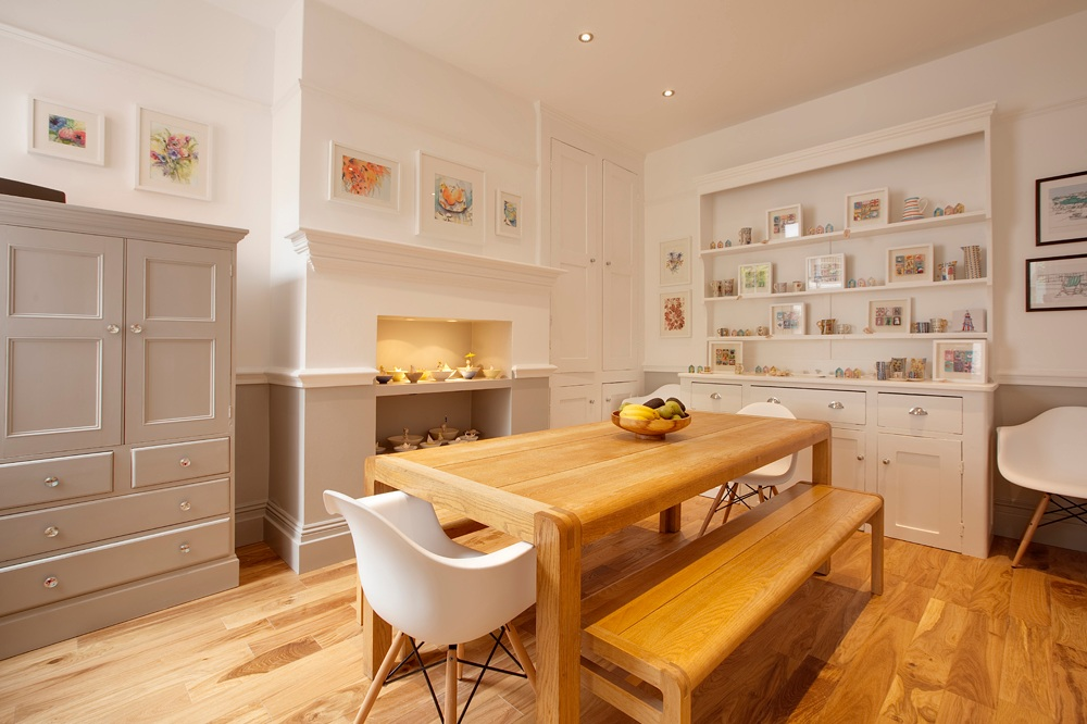 dining room with bespoke joinery and eames chairs