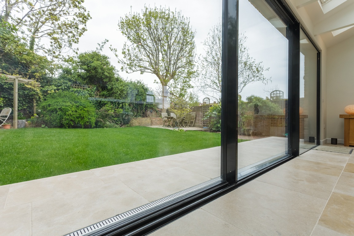 seams connection from interior to exterior as flooring extends through doors