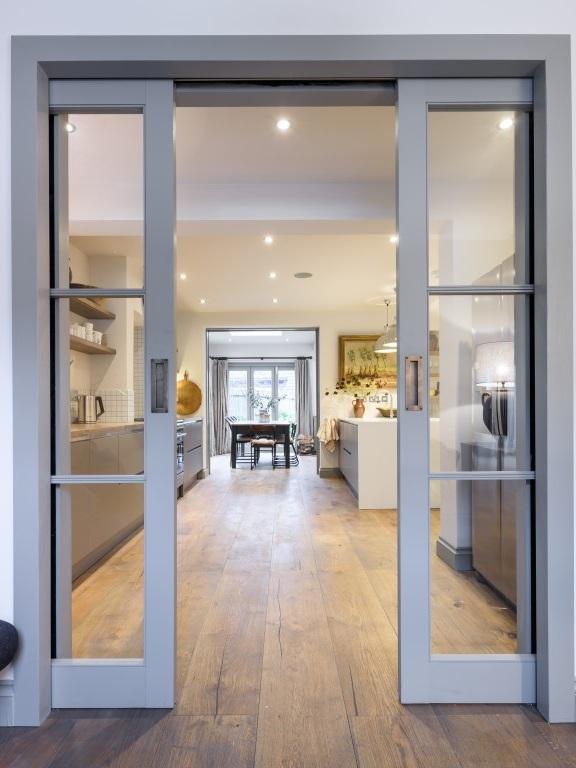 modern pocket doors and revamped kitchen
