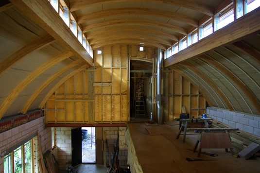 cow shed interior with glulam timber framing