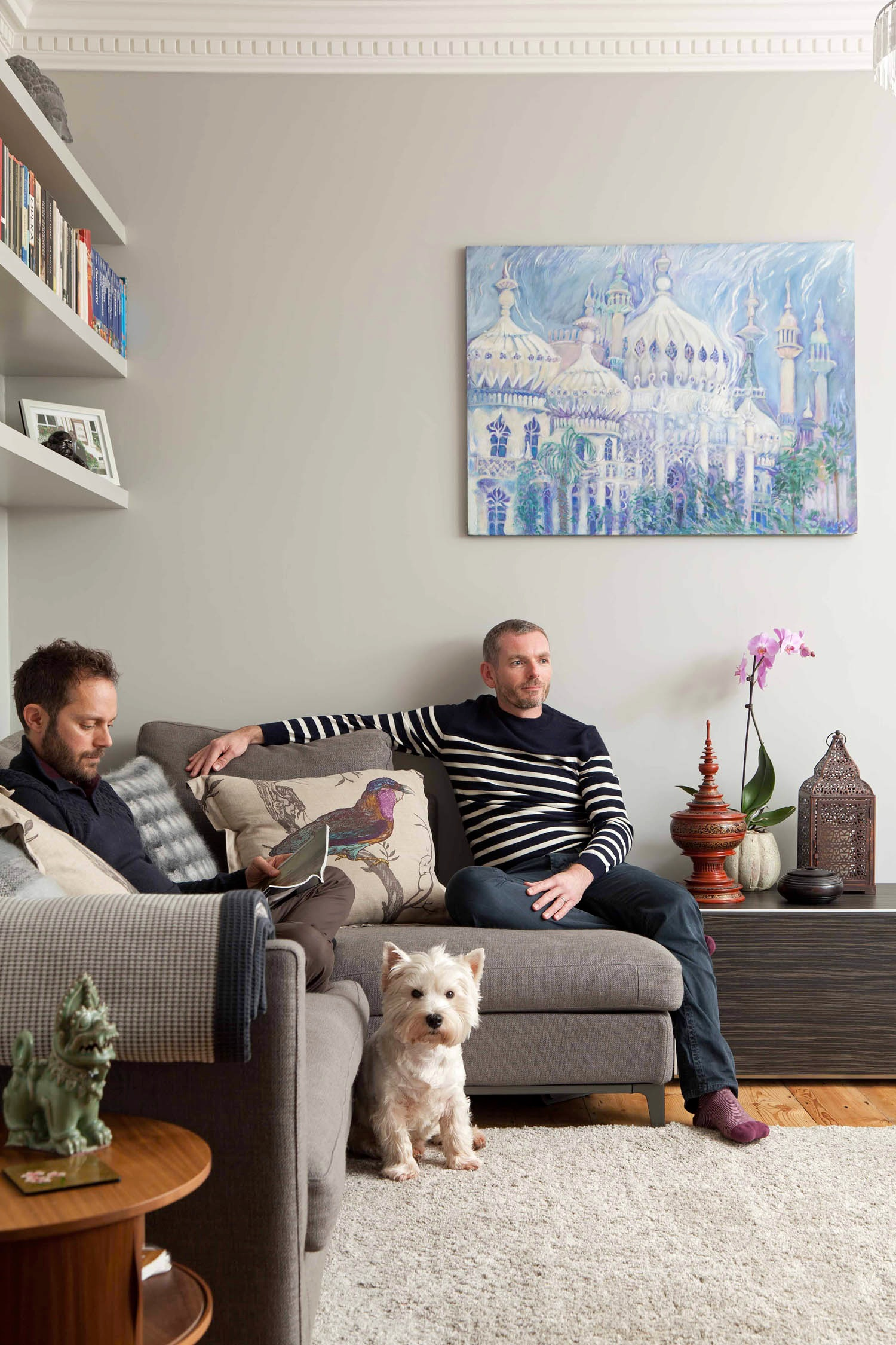cosy renovated living room of a listed building two men and a dog
